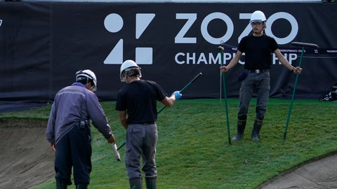 <p>               Grounds crew workers talk on the 18th green before the start of the second round of the Zozo Championship PGA Tour at the Accordia Golf Narashino country club in Inzai, east of Tokyo, Japan, Saturday, Oct. 26, 2019. (AP Photo/Lee Jin-man)             </p>