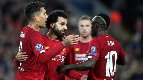 <p>               Liverpool's Mohamed Salah, second left, celebrates with teammates after scoring his side's third goal during the Champions League group E soccer match between Liverpool and Red Bull Salzburg at Anfield stadium in Liverpool, England, Wednesday, Oct. 2, 2019. (AP Photo/Jon Super)             </p>