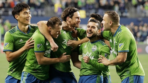 <p>               Seattle Sounders midfielder Gustav Svensson, center, celebrates with teammates after he scored a goal against Real Salt Lake during the second half of an MLS Western Conference semifinal playoff soccer match Wednesday, Oct. 23, 2019, in Seattle. The Sounders won 2-0. (AP Photo/Ted S. Warren)             </p>