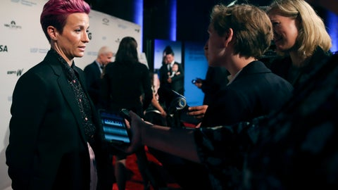 <p>               In this Wednesday, Oct. 16, 2019, photo, soccer star Megan Rapinoe talks to reporters on the red carpet of the Women's Sports Foundation's 40th annual Salute to Women in Sports in New York. Rapinoe, who was honored at the gala, won Sportswoman of the Year in the team category. She led the U.S. women's soccer team to victory at the World Cup in France and earned the FIFA Player of the Year award.  (AP Photo/Mary Altaffer)             </p>