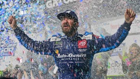 <p>               Martin Truex Jr. celebrates after winning a NASCAR Cup Series race at Martinsville Speedway in Martinsville, Va., Sunday, Oct. 27, 2019. (AP Photo/Steve Helber)             </p>