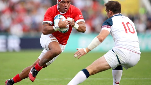 <p>               Tonga's Siale Piutau, left, runs at United States' AJ MacGinty during the Rugby World Cup Pool C game at Hanazono Rugby Stadium between USA and Tonga in Osaka, Japan, Sunday, Oct. 13, 2019. (Kyodo News via AP)             </p>