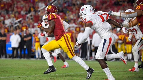 <p>               FILE - In this Aug. 31, 2019, file photo, Southern California's Velus Jones Jr., left, runs back a punt for 101 yards as Fresno State's Deonte Perry, second from right gives chase and Liam Jimmons delays Perry during the second half of an NCAA college football game in Los Angeles. Jones is off to a fast start in what is shaping up to be his most productive season as a return specialist. He is averaging 25.6 yards per kick return despite an uncommonly high number of attempts. At a time when most teams seem content to take a touchback, Jones leads the FBS with 3.8 returns per game, one of three players averaging at least three returns per game. (AP Photo/Mark J. Terrill, File)             </p>