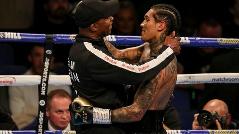 <p>               Conor Benn, right, celebrates with Nigel Benn after his WBA Continental Welterweight title boxing match with Steve Jamoye, not pictured, at the O2 Arena, London on Saturday, Oct. 26, 2019. (Paul Harding/PA via AP)             </p>