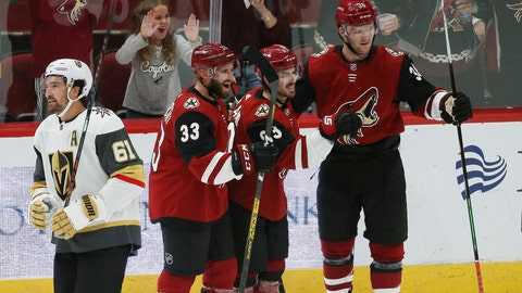 <p>               Arizona Coyotes right wing Conor Garland, second from right, celebrates his goal with Coyotes defenseman Alex Goligoski (33) and Coyotes right wing Christian Fischer (36) as Vegas Golden Knights right wing Mark Stone (61) skates past during the first period of an NHL hockey game Thursday, Oct. 10, 2019, in Glendale, Ariz. (AP Photo/Ross D. Franklin)             </p>