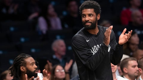 <p>               Brooklyn Nets guard Kyrie Irving reacts as he watches the action against the Sesi/Franca Basketball Club from the bench during the first half of a exhibition NBA basketball game, Friday, Oct. 4, 2019, in New York. (AP Photo/Mary Altaffer)             </p>