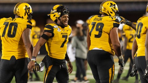 Missouri quarterback Kelly Bryant (7) celebrates with teammates after a touchdown during the third quarter of an NCAA college football game against Mississippi, Saturday, Oct. 12, 2019, in Columbia, Mo. (AP Photo/L.G. Patterson)