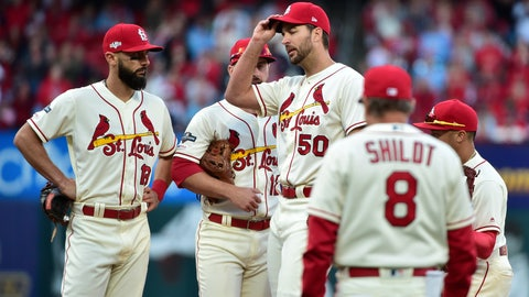 Oct 12, 2019; St. Louis, MO, USA; St. Louis Cardinals starting pitcher Adam Wainwright (50) reacts as manager Mike Shildt (8) walks to the mound to remove him from the game against the Washington Nationals during the eighth inning in game two of the 2019 NLCS playoff baseball series at Busch Stadium. Mandatory Credit: Jeff Curry-USA TODAY Sports
