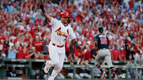 St. Louis Cardinals' Yadier Molina, left, reacts after hitting an RBI-single during the eighth inning in Game 4 of a baseball National League Division Series against the Atlanta Braves, Monday, Oct. 7, 2019, in St. Louis. (AP Photo/Jeff Roberson)