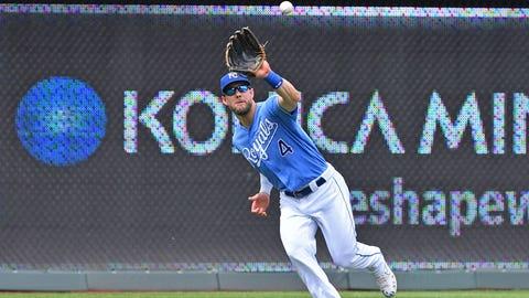 Jun 22, 2019; Kansas City, MO, USA; Kansas City Royals left fielder Alex Gordon (4) catches a fly ball against the Minnesota Twins during the ninth inning at Kauffman Stadium. Mandatory Credit: Peter G. Aiken/USA TODAY Sports