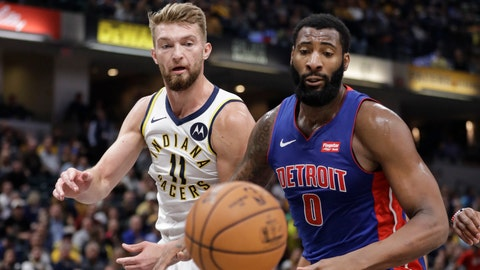 Indiana Pacers' Domantas Sabonis (11) and Detroit Pistons' Andre Drummond (0) eye a loose ball during the first half of an NBA basketball game Wednesday, Oct. 23, 2019, in Indianapolis. (AP Photo/Darron Cummings)
