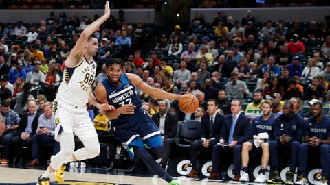 Oct 15, 2019; Indianapolis, IN, USA; Minnesota Timberwolves center Karl Anthony-Towns (32) drives to the basket against Indiana Pacers center Goga Bitadze (88) during the third quarter at Bankers Life Fieldhouse. Mandatory Credit: Brian Spurlock-USA TODAY Sports