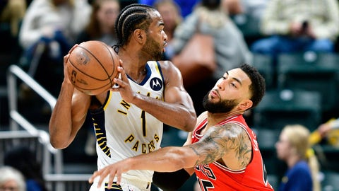 Oct 11, 2019; Indianapolis, IN, USA;Chicago Bulls guard Denzel Valentine (45) attempts to get the ball from Indiana Pacers forward T.J. Warren (1) during the second half of the game at Bankers Life Fieldhouse. The Indiana Pacers defeated the Chicago Bulls 105 to 87. Mandatory Credit: Marc Lebryk-USA TODAY Sports