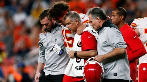 Oct 17, 2019; Denver, CO, USA; Kansas City Chiefs quarterback Patrick Mahomes (15) is helped off the field after a play in the second quarter against the Denver Broncos at Empower Field at Mile High. Mandatory Credit: Isaiah J. Downing-USA TODAY Sports