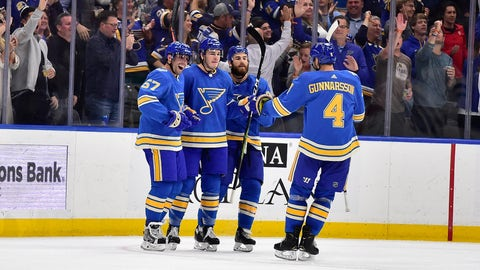 Oct 5, 2019; St. Louis, MO, USA; St. Louis Blues left wing Sammy Blais (9) is congratulated by left wing David Perron (57) and center Ryan O'Reilly (90) and defenseman Carl Gunnarsson (4) after scoring the game winning goal during the third period against the Dallas Stars at Enterprise Center. Mandatory Credit: Jeff Curry-USA TODAY Sports