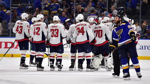 Oct 2, 2019; St. Louis, MO, USA; Washington Capitals left wing Jakub Vrana (not pictured) is congratulated by teammates after scoring the game winning goal in overtime as St. Louis Blues center Ryan O'Reilly (90) skates to the bench at Enterprise Center. Mandatory Credit: Jeff Curry-USA TODAY Sports