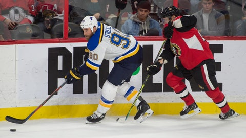 Oct 10, 2019; Ottawa, Ontario, CAN; St. Louis Blues center Ryan O'Reilly (90) skates with the puck as Ottawa Senators defenseman Nikita Zaitsev (22) defends in the second period at the Canadian Tire Centre. Mandatory Credit: Marc DesRosiers-USA TODAY Sports