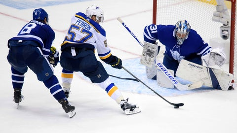 Oct 7, 2019; Toronto, Ontario, CAN; St. Louis Blues left wing David Perron (57) shoots against Toronto Maple Leafs goaltender Frederik Andersen (31) as Toronto defenseman Jake Muzzin (8) pressures during the third period at Scotiabank Arena. Mandatory Credit: Nick Turchiaro-USA TODAY Sports