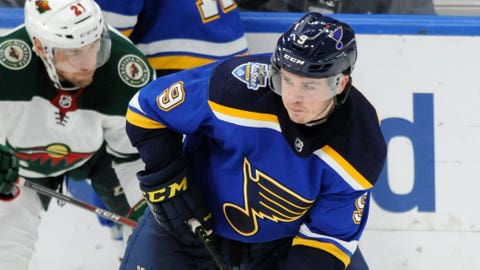 St. Louis Blues' Sammy Blais (9) looks to pass the puck in front of Minnesota Wild's Carson Soucy (21) during the third period of an NHL hockey game Wednesday, Oct. 30, 2019, in St. Louis. (AP Photo/Bill Boyce)