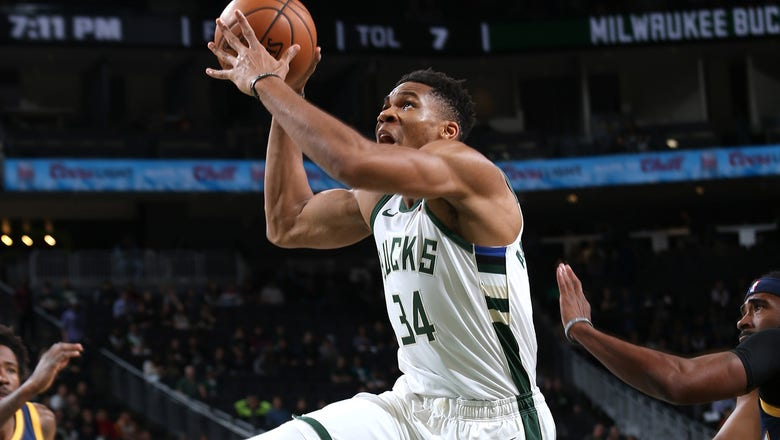 Giannis soars in preseason debut, Bucks cruise past Jazz