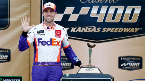 KANSAS CITY, KANSAS - OCTOBER 20: Denny Hamlin, driver of the #11 FedEx Office Toyota, poses with the trophy after wining  the Monster Energy NASCAR Cup Series Hollywood Casino 400 at Kansas Speedway on October 20, 2019 in Kansas City, Kansas. (Photo by Brian Lawdermilk/Getty Images)