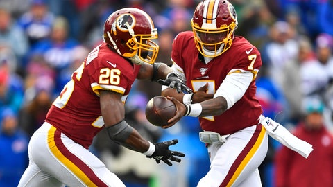 <p>               Washington Redskins quarterback Dwayne Haskins (7) hands the ball off to running back Adrian Peterson (26) during the first half of an NFL football game against the Buffalo Bills, Sunday, Nov. 3, 2019, in Orchard Park, N.Y. (AP Photo/Adrian Kraus)             </p>