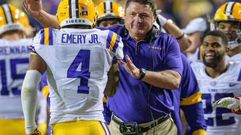 <p>               LSU coach Ed Orgeron congratulates running back John Emery Jr. (4), who scored against Arkansas during the second half of an NCAA college football game in Baton Rouge, La., Saturday, Nov. 23, 2019. (AP Photo/Matthew Hinton)             </p>