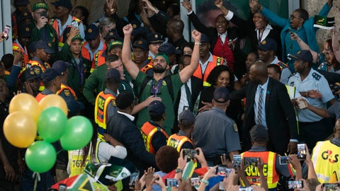 <p>               South African fans welcome their team's arrival at Johannesburg's O.R. Tambo airport Tuesday Nov. 5, 2019. South Africa defeated England 32-12 in the World Cup Rugby final Saturday Nov. 2 in Tokyo. (AP Photo/Jerome Delay)             </p>