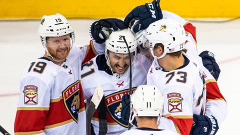<p>               Florida Panthers defenseman Mike Matheson (19) and left wing Dryden Hunt (73) celebrate with center Vincent Trocheck (21) after he scored during the shootout in the team's NHL hockey game against the New York Rangers, Sunday, Nov. 10, 2019, in New York. (AP Photo/Corey Sipkin)             </p>