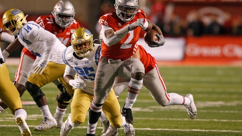 <p>               Utah running back Zack Moss (2) out runs UCLA linebacker Jason Harris (95) in the first half during an NCAA college football game Saturday, Nov. 16, 2019, in Salt Lake City. (AP Photo/Rick Bowmer)             </p>