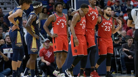 <p>               Toronto Raptors forward Serge Ibaka (9) leaves the court with the help of guard Fred VanVleet (23) and guard Norman Powell (24) as New Orleans Pelicans guard Jrue Holiday (11) and center Jaxson Hayes (10) watch during the first half of an NBA basketball game in New Orleans, Friday, Nov. 8, 2019. (AP Photo/Matthew Hinton)             </p>