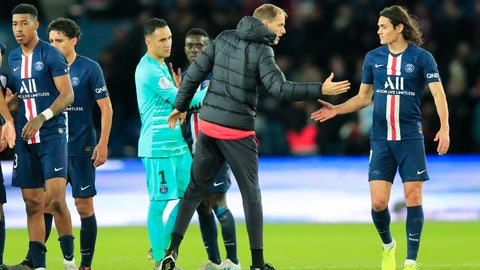<p>               PSG coach Thomas Tuchel, second right, celebrates with teammate Edinson Cavani at the end of the French League One soccer match between Paris Saint-Germain and Lille at the Parc des Princes stadium in Paris, Friday, Nov. 22, 2019. PSG won 2-0. (AP Photo/Michel Euler)             </p>