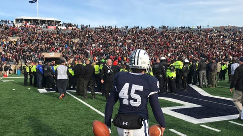 <p>               Yale punter Jack Bosman watches as demonstrators stage a protest on the field at the Yale Bowl disrupting the start of the second half of an NCAA college football game between Harvard and Yale, Saturday, Nov. 23, 2019, in in New Haven, Conn. (AP Photo/Jimmy Golen)             </p>