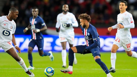 <p>               PSG's Neymar, center, vies for the ball with Lille's Boubakary Soumare, left, during French League One soccer match between Paris Saint-Germain and Lille at the Parc des Princes stadium in Paris, Friday, Nov. 22, 2019. (AP Photo/Michel Euler)             </p>