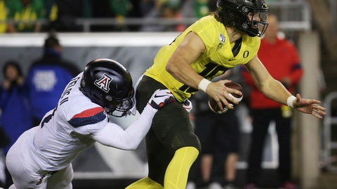 <p>               Arizona's Tony Fields II, left, sacks Oregon quarterback Justin Herbert during the second quarter of an NCAA college football game Saturday, Nov. 16, 2019, in Eugene, Ore. (AP Photo/Chris Pietsch)             </p>