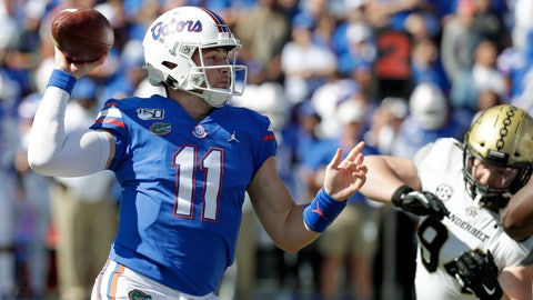 <p>               Florida quarterback Kyle Trask (11) throws a pass as he is pressured by Vanderbilt defensive lineman Rutger Reitmaier, right, during the first half of an NCAA college football game, Saturday, Nov. 9, 2019, in Gainesville, Fla. (AP Photo/John Raoux)             </p>