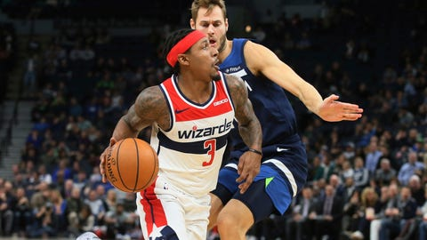 <p>               Washington Wizards' Bradley Beal (3) eyes the basket as he drives past Minnesota Timberwolves' Jake Layman in the second half of an NBA basketball game Friday, Nov 15, 2019, in Minneapolis. (AP Photo/Jim Mone)             </p>
