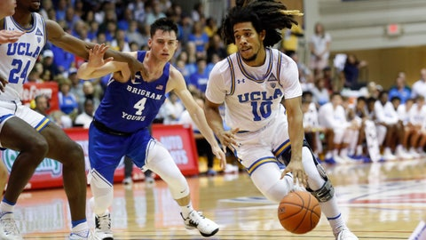 <p>               UCLA guard Tyger Campbell (10) gets past BYU guard Alex Barcello (4) during the first half of an NCAA college basketball game, Monday, Nov. 25, 2019, in Lahaina, Hawaii. (AP Photo/Marco Garcia)             </p>