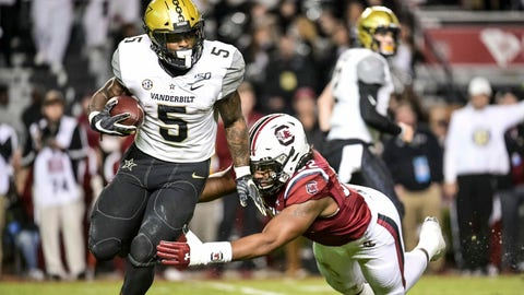 <p>               Vanderbilt running back Ke'Shawn Vaughn (5) runs with the ball as South Carolina defensive lineman Kingsley Enagbare (52) tries to make the tackle during the second half of an NCAA college football game Saturday, Nov. 2, 2019, in Columbia, S.C. South Carolina defeated Vanderbilt 24-7. (AP Photo/Sean Rayford)             </p>