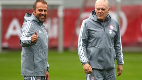 <p>               New Bayern Munich head coach Hansi Flick, left, and his assistant Hermann Gerland arrive for a training session prior to the Champions League group B soccer match between Bayern Munich and Olympiakos in Munich, Germany, Tuesday, Nov. 5, 2019. Bayern will face Olympiakos on Wednesday. (AP Photo/Matthias Schrader)             </p>