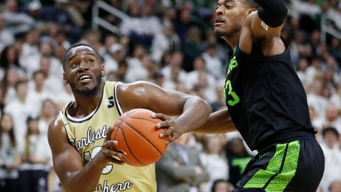 <p>               Charleston Southern forward Ty Jones, left, is defended by Michigan State forward Xavier Tillman (23) during the first half of an NCAA college basketball game, Monday, Nov. 18, 2019, in East Lansing, Mich. (AP Photo/Carlos Osorio)             </p>