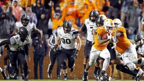<p>               Tennessee running back Eric Gray (3) gets past the Vanderbilt defense en route to a 94-yard touchdown in the first half of an NCAA college football game Saturday, Nov. 30, 2019, in Knoxville, Tenn. (AP Photo/Wade Payne)             </p>