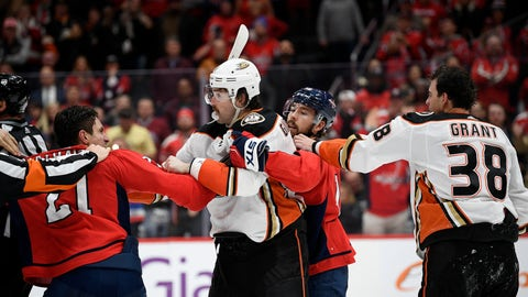 <p>               Washington Capitals right wing Garnet Hathaway (21) scuffles with Anaheim Ducks defenseman Erik Gudbranson, second from left, during the second period of an NHL hockey game, Monday, Nov. 18, 2019, in Washington. Also seen is Capitals center Chandler Stephenson, second from right, and Ducks center Derek Grant (38). (AP Photo/Nick Wass)             </p>