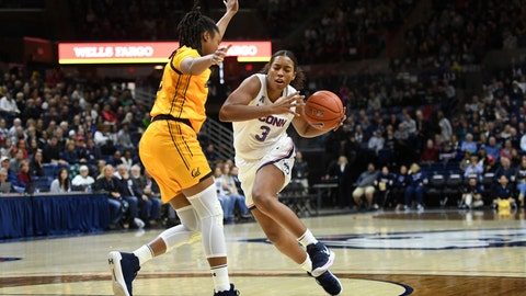 <p>               Connecticut's Megan Walker (3) drives around California's Jaelyn Brown (33) in the first half of a women's NCAA college basketball game, Sunday, Nov. 10, 2019, in Storrs, Conn. (AP Photo/Stephen Dunn)             </p>