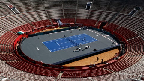 <p>               Workers add the finishing touches at the Plaza de Toros bullfighting ring that has been converted into a tennis court to host an exhibition tennis match between Swiss great Roger Federer and German rival Alexander Zverev, in Mexico City, Friday, Nov. 22, 2019. (AP Photo/Rebecca Blackwell)             </p>