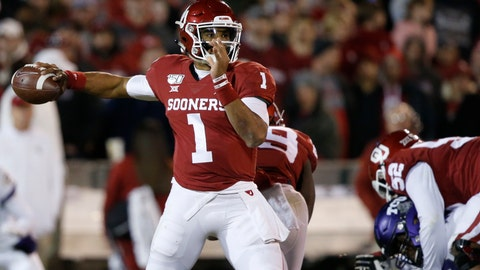<p>               Oklahoma quarterback Jalen Hurts (1) passes in the first half of an NCAA college football game against TCU in Norman, Okla., Saturday, Nov. 23, 2019. (AP Photo/Sue Ogrocki)             </p>