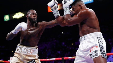<p>               Deontay Wilder, left, fights Luis Ortiz in a heavyweight title boxing match Saturday, Nov. 23, 2019, in Las Vegas. (AP Photo/John Locher)             </p>