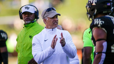 <p>               Wake Forest head coach Dave Clawson, center, talks to his team as they play North Carolina State in the second half of an NCAA college football game in Winston-Salem, N.C., Saturday, Nov. 2, 2019. Wake Forest won 44-10. (AP Photo/Nell Redmond)             </p>