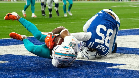 <p>               Dolphins defensive back Steven Parker (26) rolls away with the ball after stripping it in the end zone from Indianapolis Colts tight end Eric Ebron (85) during the first half of an NFL football game in Indianapolis, Sunday, Nov. 10, 2019. The play was rule an interception by Parker. (AP Photo/AJ Mast)             </p>