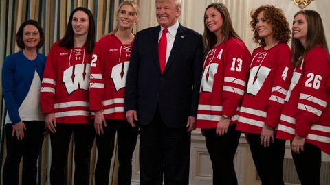 <p>               President Donald Trump poses for photos with members of the University of Wisconsin-Madison Women's Hockey Team during the NCAA Collegiate National Champions Day at the White House, Friday, Nov. 22, 2019, in Washington. (AP Photo/ Evan Vucci)             </p>